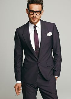 Simple well tailored single button charcoal suit with a touch of personal flair with the purple