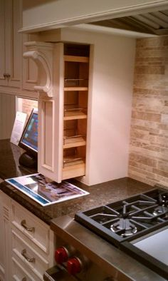 Kitchen spice pull out cabinets on both sides of range