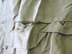 This torn hem was difficult to repair because of the many-tiered and lined construction.