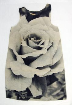 HARRY GORDON, ROSE POSTER DRESS 1968: screen-printed paper dress. the link also has pictures of the dress folded for sale in an original plastic sleeve.