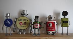 Assemblage of junk robots in art metals with upcycling Sculpture Robots Reused Recycled Metal Junk Found objects Assemblage