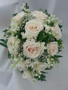 Romantic Wedding Bouquet Showcasing: White Lily Of The Valley, White Bouvardia, White Gypsophila (Baby's Breath), Light Creamy Blush Roses, Evergreen Foliage, Green Leather Leaf Fern + Additional Greenery