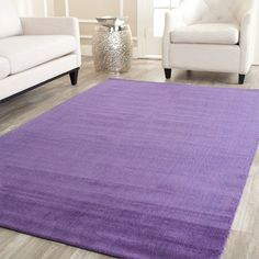 Hand-loomed wool rug.  Product: RugConstruction Material: WoolColor: PurpleFeatures:...