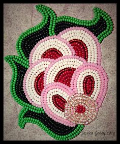 One of my all time favorite flowers I have beaded. The design is inspired by older Ojibwe Floral Patterns. Jessica Gokey 2013