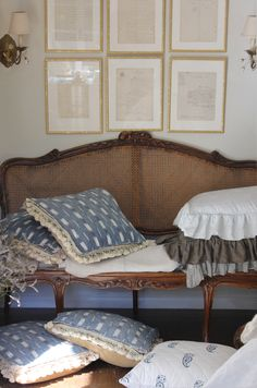 Trouvais French 18th canape with 18th c French quilted ikat (Textile Trunk) on pillows, framed antique French letters