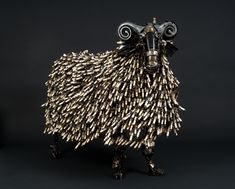 Amazing steampunk sheep sculpture by James Corbett.  Love the use of spark plugs!  #steampunk