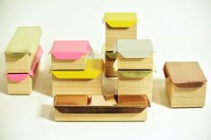 Designer Sami Kallio's storing wood boxes come in various sizes and colors.