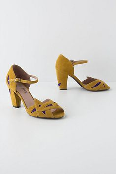 A delightful pair of golden yellow and bright blue vintage style shoes.