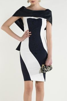 https://www.cityblis.com/4454/item/15046 | Style:  113 Gracey - $577 by NICO DIDONNA | The embossed Black- navy and white dress ensures an elegant feminine look with luxury detail on back of dress. Drapes beautifully over the shoulders. Ideal for an evening of cocktails and glamor  Material: Mixed Fiber Fitted to body • contrast colours  • Large bow at back • Draped ... | #Dresses