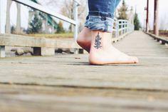 Tattoo of Oregon fir tree as depicted on the Oregon license plate Portland tattoos ink photography St. John's bridge