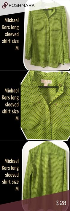 """Michael Kors Long sleeved shirt size Item Description Long sleeved w/Hidden button   Maker/Markings Michael Kors   Tag Size M -USED Condition: Appears to be in good condition  Approximate Measurements Shoulder to Shoulder:16"""" Bust/Chest:38"""" Sleeves:27"""" Length:33"""" Waist:N/A Inseam:N/A  Color Multi   Fabric/Material Polyester Michael Kors Tops Button Down Shirts"""