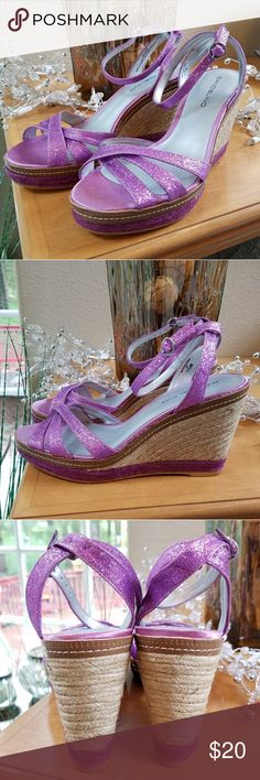 New Bandolino Purple Sparkle Wedges Size 7.5 Brand new never worn!  These Bandolino wedges feature a metallic purple Sparkle upper with ankle strap on a jute braided wedge heel that is 3.5 inches. Beautiful shoes to Jazz up your summer outfits Bandolino Shoes Wedges