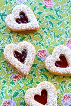 Linzer Cookies Recipe - just made these, super yummy!! :) i used apricot, raspberry, and strawberry jam, and even did some with nutella!