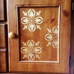 Raised Stenciling with Pale Gold on a buffet door by creative customer Dr. Shamika Mitchell | DIY Cabinet Door Ideas