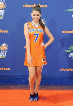 Kira Kosarin in an orange jersey dress
