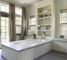 Hickman Design Associates: Master bathroom with French doors and transom windows covered in floor to ceiling taupe ...