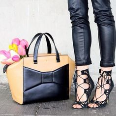 Strappy heels and sleek tote