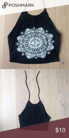 "Halter Crop Top This black halter crop top features a white mandala print on the front and ties at the back of the neck.  Labeled XL but fits a size L best. Measurements: Bust-36.2"", Length-14.4""  NWOT Tops Crop Tops"