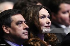 France's First Lady Carla Bruni Sarkozy and France's Prime minister Francois Fillon attend a campaign meeting of French President and UMP candidate for 2012 presidential election, on February 19, 2012 in Marseille, southeastern France. President Nicolas Sarkozy attempted to rally his troops today with a call for the French people to stand with him against a defeatist elite and to defend the traditional values of a strong France. AFP PHOTO / LIONEL BONAVENTURE