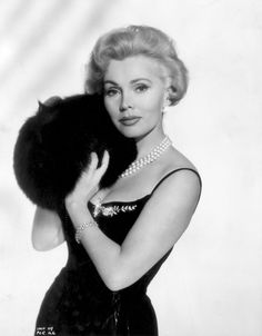 """Husbands are like fires. They go out if unattended."" - Zsa Zsa Gabor"