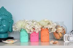 Add some beach-y vibes to your office or homewith these pretty and inexpensive painted mason jars. Perfect for organizing your...