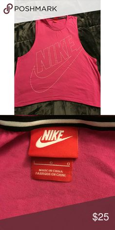 Pink Nike Tank Top Pink Nike Tank Top with cutoff style sleeves. New without tags. Never worn. Nike Tops Tank Tops