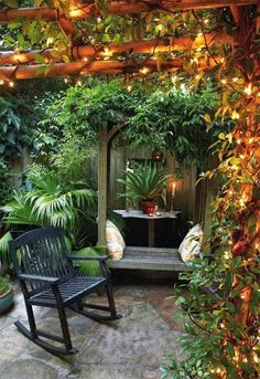 Secret Gardens: Backyard Gardening Ideas - {ChrisSinc: I like this idea for around the bbq gazebo area. Hanging plants and lighting}