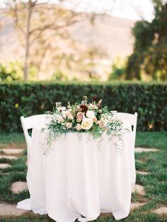 Flowers: Enchanted Garden Floral Design // Photography: Erin J Saldana Photography - www.erinjsaldana.com   Read More on SMP: http://www.stylemepretty.com/california-weddings/2016/02/09/charming-romantic-maravilla-gardens-wedding/ blush marsala peach burgundy bouquet dahlia ranunculus garden rose sweetheart table