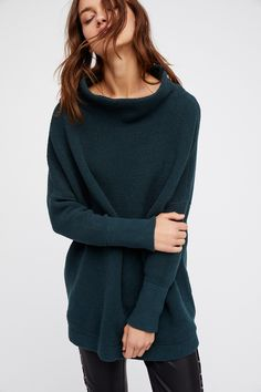 Ottoman Slouchy Tunic   Heavy knit ribbed sweater tunic in a slouchy, oversized stretchy fit. Features a sleek mock neck.