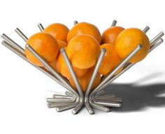 Add a unique visual aesthetic to your dining table or kitchen counter top by storing fruit in the Euro Satin Nickel Starburst Fruit Bowl.  This cool kitchen accessory is ideal for stylish storage of fresh produce or baked goods such as bagels and rolls and provides a contemporary touch that leaves a lasting impression