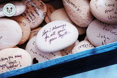 Rocks: Guests wrote their loving thoughts for the happy couple down on rocks and placed them into a basket.
