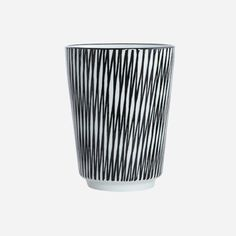 House Doctor Striped Mug: These beautiful striped mugs by House Doctor are made of hand decorated porcelain.