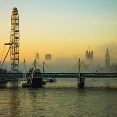 London Eye, the rive Thames and Westminster in morning mist...