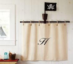 I so either want to DIY one of these, or something like this for curtains.