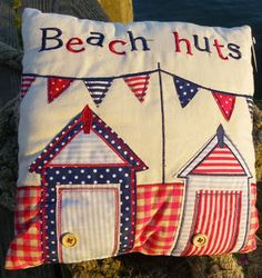 Beach huts and bunting in one handy cushion!