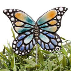 Ceramic butterfly garden art. Monarch butterfly garden decor. Multi coloured. www.gvega.com.