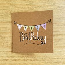 Happy Birthday Bunting Card  This 102mm x 102mm handmade card is decorated with cute multi-pattern bunting, with hand written Happy Birthday lettering  Comes with a matching envelope and a protective plastic bag. The inside of the card is blank for your personal message  The back is stamped with my logo for authenticity