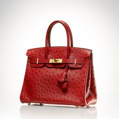 A red ostrich leather Birkin bag, 30 cm, Gilt metal hardware, keyfob & padlock, double handle.  Year: 2008