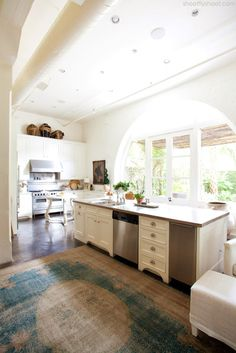 Atchison Home | Kitchen | Arched Doorway | Antique Rug. Striking white kitchen, The Lettered Cottage.