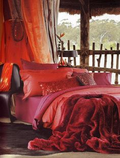 Beautiful red bed - just want to climb in!