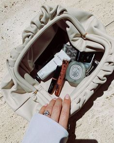 From Rosie Huntington-Whiteley to countless influencers, we keep spotting Bottega Veneta s clutch bag all over the place. See and shop here. Rosie Huntington Whiteley, Inside My Bag, What In My Bag, Perfume, Ootd, Pouch Bag, Luxury Bags, Bottega Veneta, Makeup