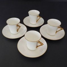 Doulton deco: unnamed demitasse / coffee cup duos, c1936-7 (9,10; saucers impressed 2-2-37). Crisp white ground with gold highlights and trim.