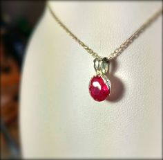 Hand-crafted 100% pure Silver pendant with Sterling Silver bale holding a 2.17ct CZ Garnet. Made by me!