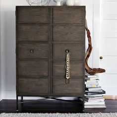 Your new high-fashion wardrobe. Our Paneled Armoire is equipped to store anything from dresses and suits to flat screens. Open the doors to reveal two adjustable shelves, a removable clothing bar and cutouts for electronics cords.