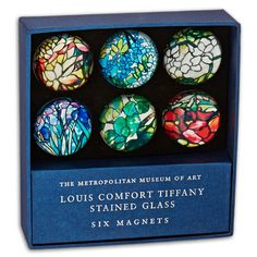 Details of six Louis Comfort Tiffany glass pieces come alive in this magnet set.