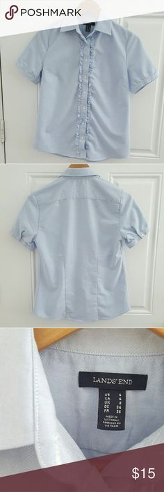 Lands End Fitted Button down with Ruffles This crisp blue button down has added feminine ruffles. Dress up for the office or down for the weekend. Short sleeves have button closures. Side length is 22 inchs. Length from collar to tail is 25 inchs.  If you love this top please make an offer :) Lands' End Tops Button Down Shirts