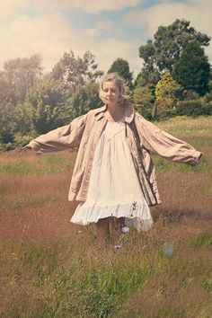 Secret Garden wearing Les Ours dress and Magnolia Pearl shirt