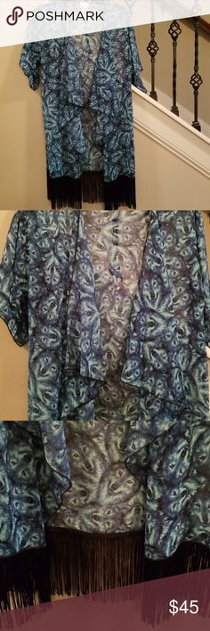 NWOT Wolves Lularoe Monroe Brand new! This piece is rare with the green wolves and orange eyes. Great cover up for swimsuit or dress up your blue Jean's for a night out! Lularoe Jackets & Coats