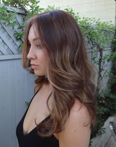 perfect layered brunette with caramel highlights