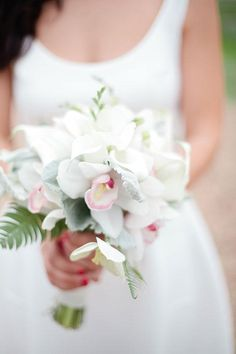 An orchid and freesia wedding bouquet | @rivetsandroses | Brides.com
